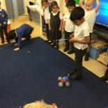 While learning about technology, one child very kindly let his friends have a turn at using his remote control car. Several children were able to use the buttons well to control the car around the carpet.
